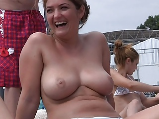 Women with huge tits topless on the beach