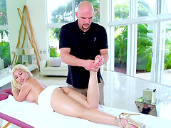 Blonde babe gets a massage and a deep pussy drilling