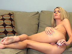 Graceful blonde chick and her purple toy in the amazing solo action