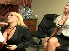 Blonde MILF fucks in an office in the eyes of another woman