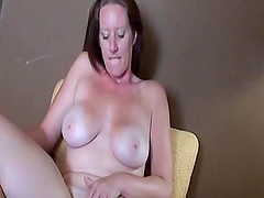 Busty chick goes totally naked and masturbates the shaved pussy