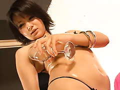Bodacious Asian GF oils her pussy and spoils it with fingers