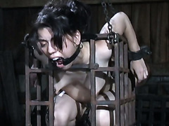 Caged Asian beauty Felonie gets her anus and pussy drilled with tools her BDSM master used