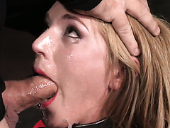 Tightly restrained slim cutie Mona Wales got her mouth stretched with 2 hard dicks