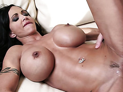 Tight bodied MILF with big tits loves fucking on the couch and it shows