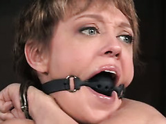 Dee Williams is having a nice pussy toying session in the dungeon