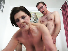 Chubby and experienced cougar rides on a young white man
