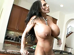Fake tittied brunette milf gets her cunt fucked hard by horny dude right on the kitchen table
