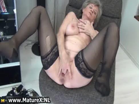Sexy granny in black stockings loves