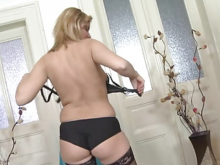 Mature plays, toys and cums in black stockings