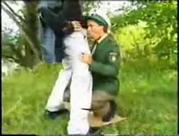 Chick in uniform banged on the grass