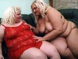Two fat blonde having fun with a dildo