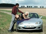 Busty mature gets fucked outside on a car's hood