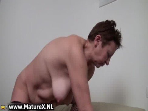 Old busty housewife spreading legs