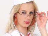 Sexy nurse Mia Hilton spreads her pussy