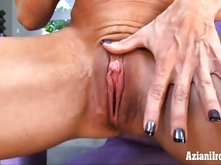 Mature Musclar woman fingers her wet pussy