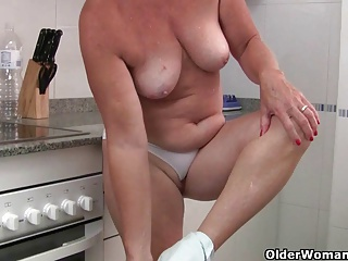 Grandma wears see through white pants and masturbates