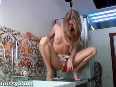 Teen peeing on kitchen sides