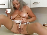 Horny grandma in kitchen