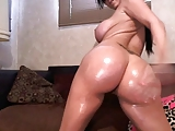 Busty brunette with a fake ass dances
