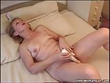 Blonde granny Eva fucks herself with a vibrator