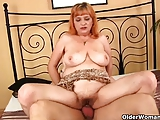 Redheaded granny with big tits sucks cock and gets fucked