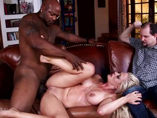 Holly Heart lets her cuckold husband watch her fuck black cock