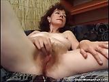 Hairy granny masturbates with a dildo