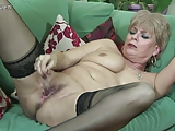 British granny pleases herself on couch