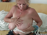 Granny with big tits masturbates in pantyhose