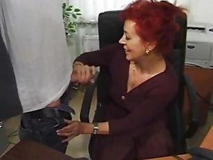 Redhead mature office slut