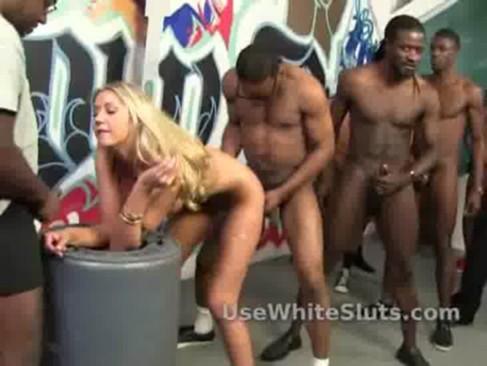 White slut used by black cocks as she sucks them all