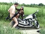 Busty babe gets plowed on a motorcycle