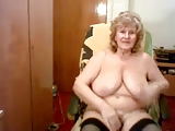 Nice looking old granny masturbates on a chair