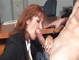 Mature redhead at work