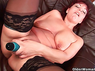 Mature mom lubes up her big tits and fuckable pussy