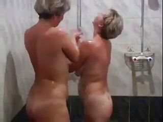 Two Matures Play with Each Other Then Some Cock