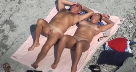 Busty Mature Lady Gives A Blowjob To Her Hubby On A Nude Beach