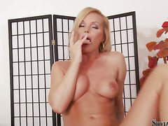 Silvia Saint kills time stroking her cunt