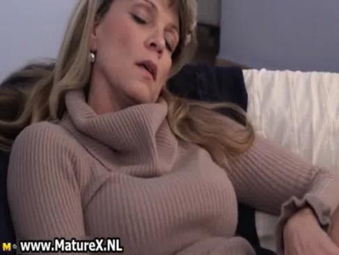 Older mature woman enjoys laying