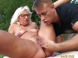 Grandma fucks stud outdoors
