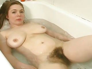 Young hairy redhead bathes & lotions her hairy body