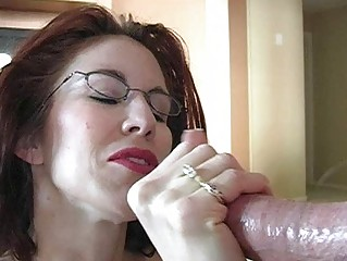 Sporty busty redhead momma works on her cock sucking skills