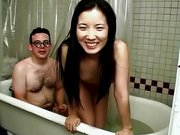 With Asian chick in the bath