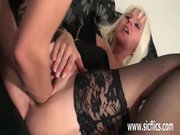 Platinum blond milf double fisted in her twat