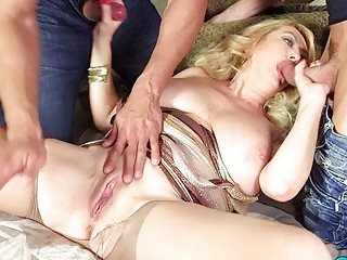 Busty Tahnee Taylor eats two pricks