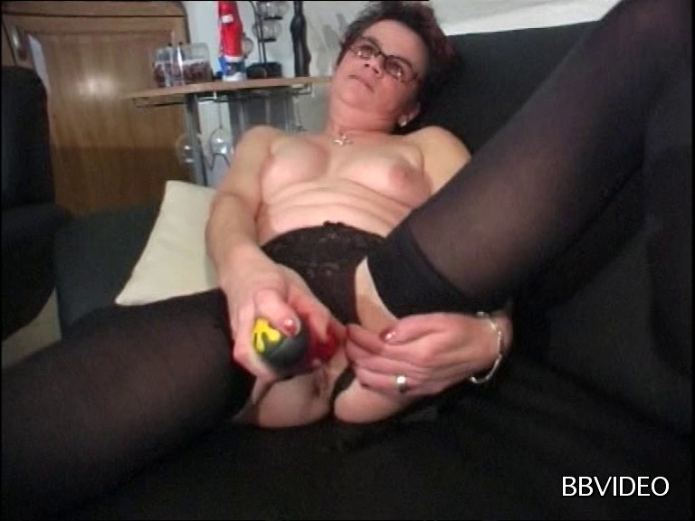 Horny Granny Could Not Help Soaking A Huge Dildo In Her Wet Cooter