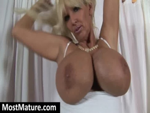 huge round mature breasts make all men horny