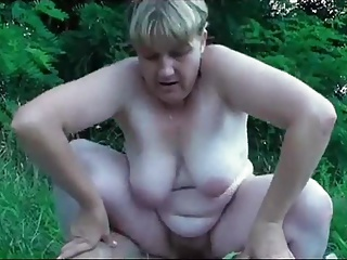 German granny pleases young man outdoor