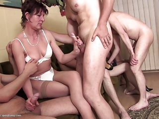 Mature mothers have group sex with young boys
